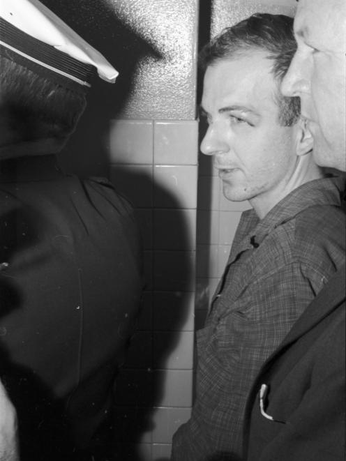 Lee Harvey Oswald in police custody in Dallas following assassination of President John F Kennedy...