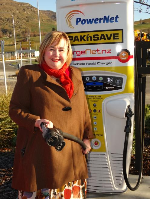 Energy and Resources Minister Megan Woods unveils Queenstown's first high-speed electric vehicle charger at the Pak'nSave supermarket car park in Frankton yesterday. Photo: Guy Williams