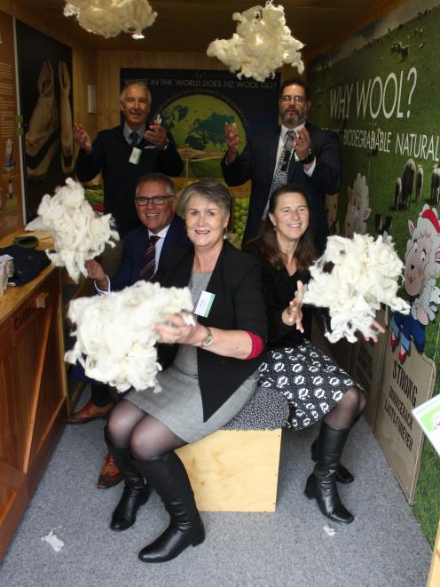 Celebrating the launch of the ``wool shed'' at Aparima College are (clockwise from back left) PGG Wrightson Wool general manager Grant Edwards, Campaign for Wool trustee Craig Smith, Wool in Schools project manager Vicki Linstrom. Aparima College head of