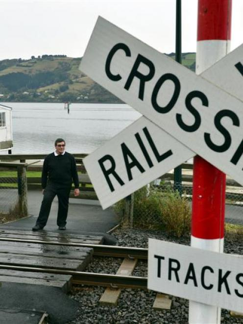 The railway crossing on the shared path at the Ravensbourne Boating Club.