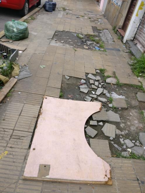 A broken footpath is typical of the standard of the streets of Buenos Aires.