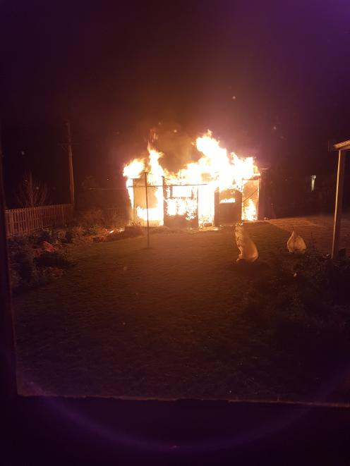 A garage at 18 Lewin St, Balclutha, shortly after emergency services were called about 12.30am this morning. Photo: Supplied