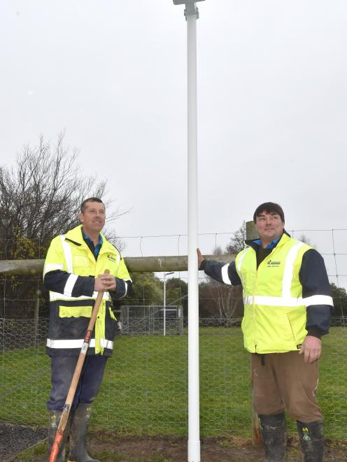 Animal control officers Alister Wilden (left) and Tony Newman with a newly installed solar light...