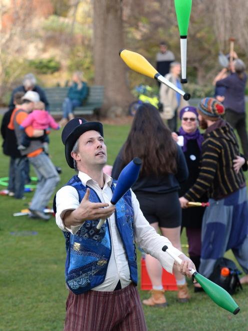Dunedin Fire and Circus Club president Miguel Nitis demonstrates his juggling skills at the...