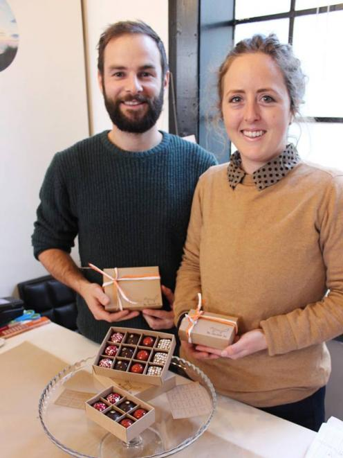 Founders of The Chocolate Fox, John Waller (left) and Cilla Bertram, with a range of their handmade chocolates now available at Guild in Dunedin. PHOTO: ELLA STOKES