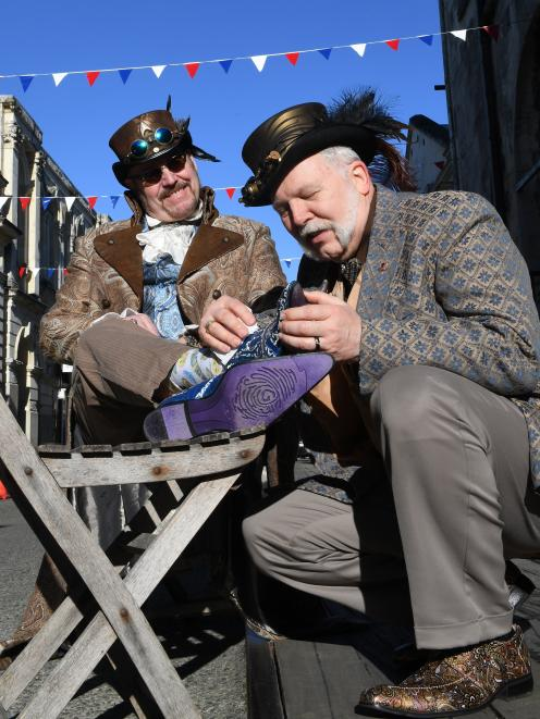 Allen Borgwardt (right) makes sure Bob Archer looks his best for this weekend's Steampunk NZ...