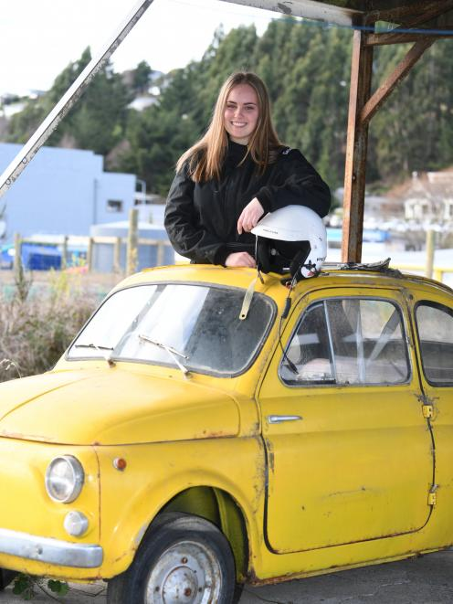 Nikita Gibson stands in the family's beloved Fiat Bambina car. Photo: Stephen Jaquiery