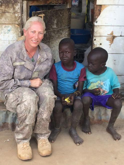 Lieutenant-colonel Lisa Kelliher talks to children during a visit to the Bor in eastern South...