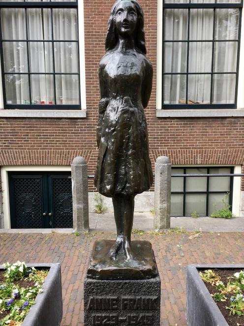 Anne Frank sculpture, by Mari Andriessen, in Westerkerk Church Square.