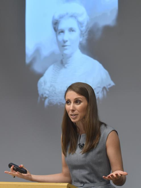 Writer, musician and activist Lizzie Marvelly, in front of a photo of New Zealand suffragette Kate Sheppard, delivers the 2018 Michael King memorial lecture at the University of Otago last night. Photo: Gregor Richardson