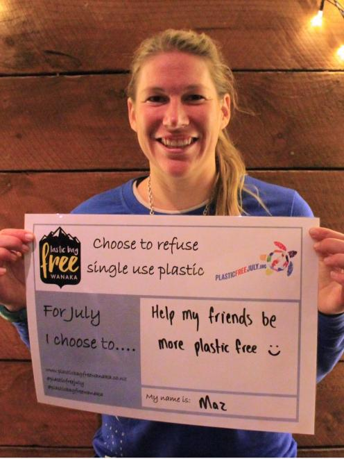 Marian Krogh with her Plastic Free July pledge to help her friends be more plastic-free. Photo:...
