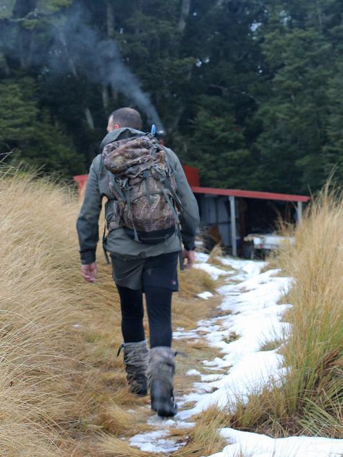 Shanon returns on the last day with a venison-laden pack.