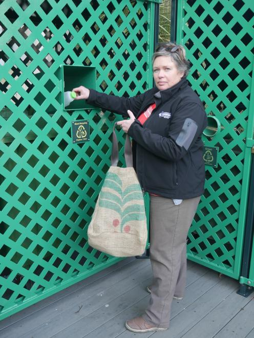 Dunedin City Council waste and environmental solutions education and promotions officer Catherine Gledhill recycles a plastic milk bottle in the council's Moray Pl recycling hub on Tuesday. Photo: Jessica Wilson
