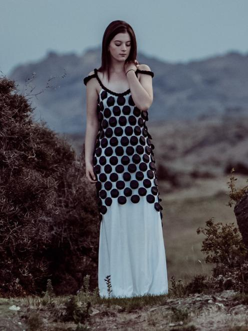 Lauder Station designer Becs Calder's 2014 entry in the WoolOn Creative Fashion Event, Chain Reaction, photographed against a Central Otago backdrop. The garment won that year's special occasion category. Photo: Supplied