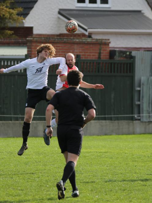 Caversham's Aaron Corkhill cops an elbow from Roslyn's Nick Treadwell during their premier club...