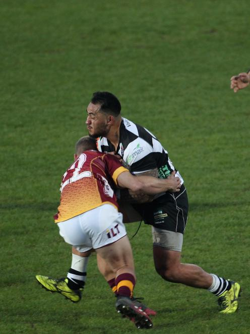 Hawke's Bay wing Pasqualle Dunn (right) crashes into Southland replacement back Broc Hooper...