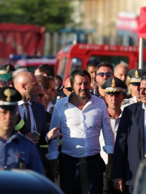 Italian Interior Minister Matteo Salvini leaves the site of the collapsed Morandi Bridge. Photo: Reuters