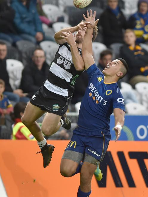 Otago second five-eighth Sio Tomkinson and Hawke's Bay winger Mason Emerson compete for Tomkinson...