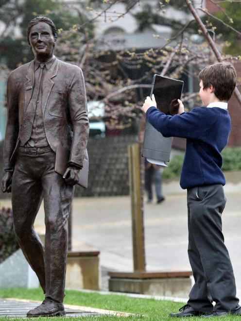 John McGlashan pupil Esteban Garcia (11) captures an image of the sculpture, which was  created...