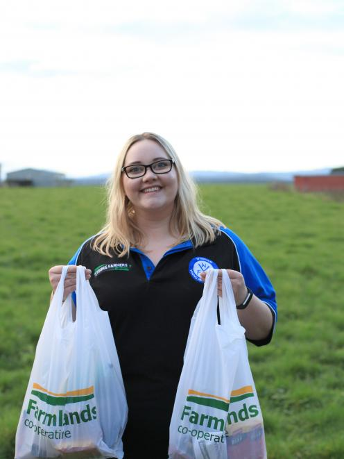 Wyndham Young Farmers member Allesha Ballard holds up a couple of care packages she put together...