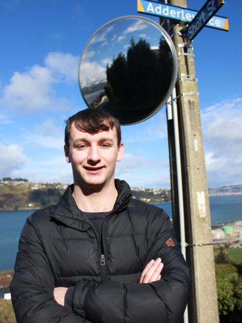 West Harbour Community Board member Ryan Jones shows off a new traffic mirror placed on the...
