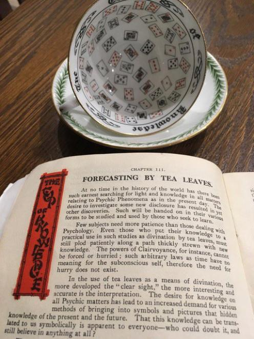 A numbered souvenir cup from the 1925-26 exhibition with its accompanying booklet, A Key To The Mysteries Of Divination, by Willis MacNicol. Photo: Carol Montgomery