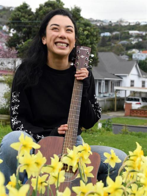 Busker Deina Susilo-Knox, who got $20 from Pink while busking at the Otago Farmers Market on...