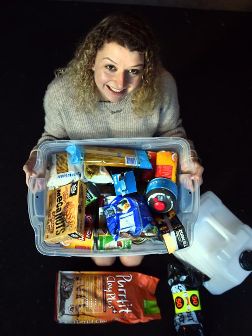 University of Otago student Jennifer Forrest with her emergency kit. Photo: Peter McIntosh