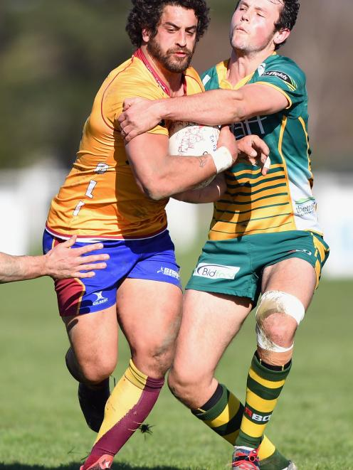 Taina Tamou of North Otago is tackled by Tom Hanham-Carter of Mid Canterbury during the round two...