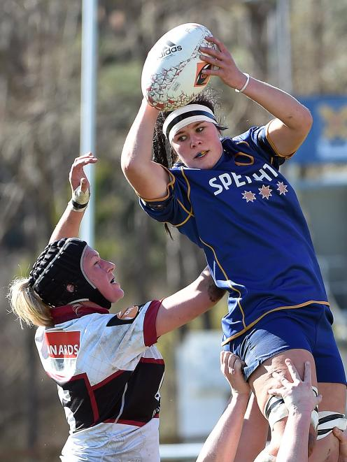 Otago Spirit lock Jess Kendall takes the ball contested by North Harbour lock Rebecca Wood during...