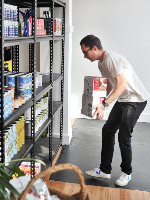 Jarred Bishop, Penelope Baldwin's cousin, helps out stacking shelves and has created the graphics for the store.