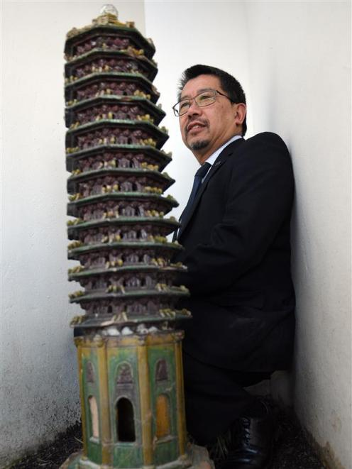 Dunedin Chinese Garden Trust chairman Malcolm Wong looks at the rare ceramic pagola given to the garden earlier this year. Photo: Stephen Jaquiery