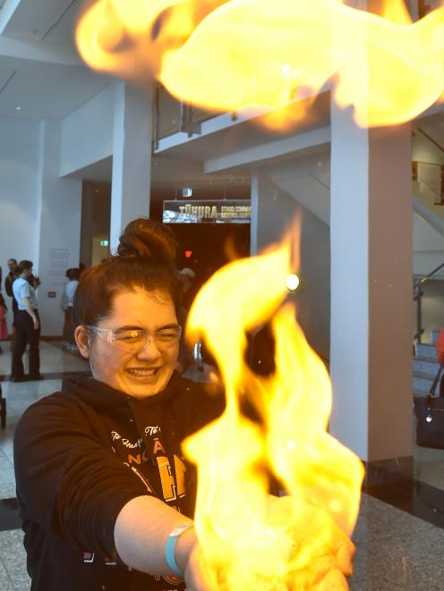 """University of Otago foundation year health science student Taingarue Mataira (18) becomes a """"human candle'' at the Otago Museum's science centre yesterday. Photo: Gregor Richardson"""