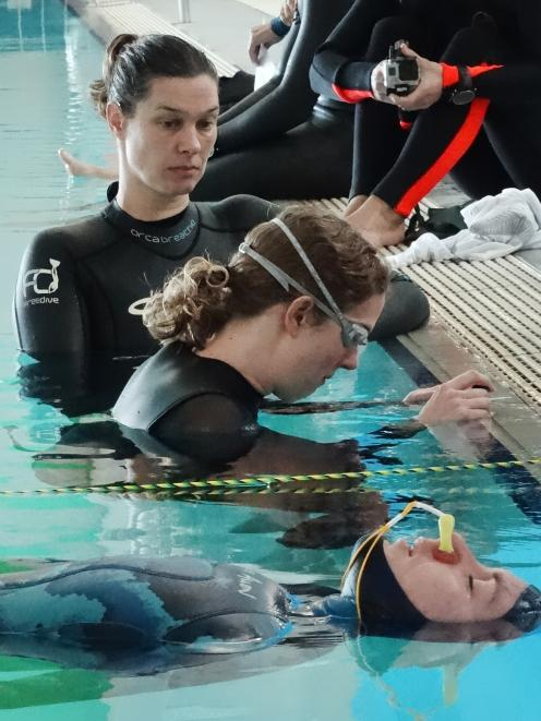 Preparing for their static apnea breath holds are (bottom) Gemma O'Brien, of Northland, and...