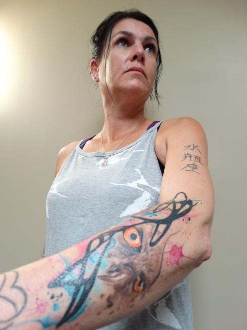 Oamaru's Mel Rushton shows off her  tattoo of an owl at the Tattooed & Proud show at the Oamaru...
