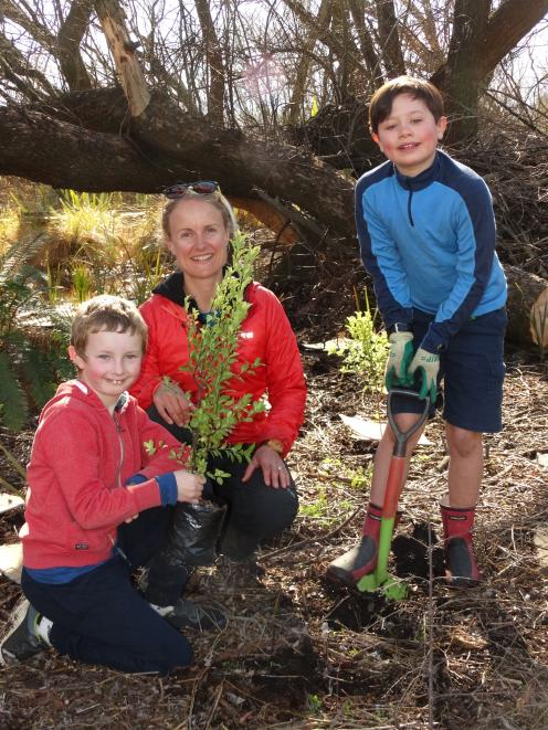 Helping out at a Wakatipu Reforestation Trust community planting day by Lake Hayes on Saturday...