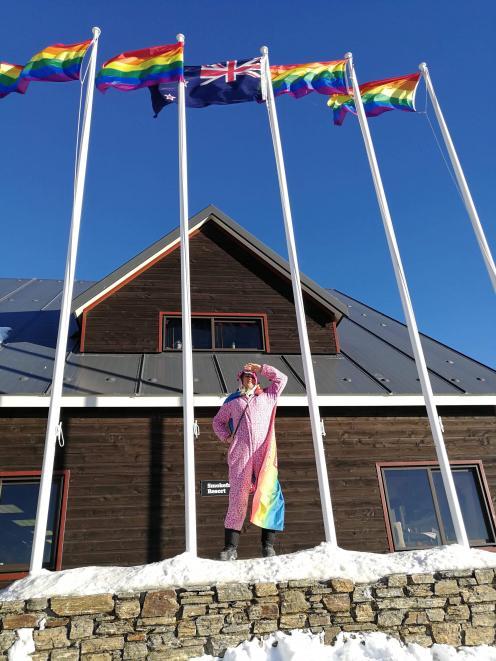 Cardrona staff member Bindy Doust salutes Winter Pride on the mountain yesterday. Photo: Cardrona Alpine Resort