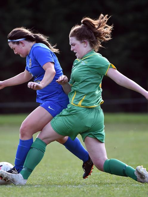 Southern United midfielder Chelsea Whittaker (left) and Central's Florence Macintyre dispute...