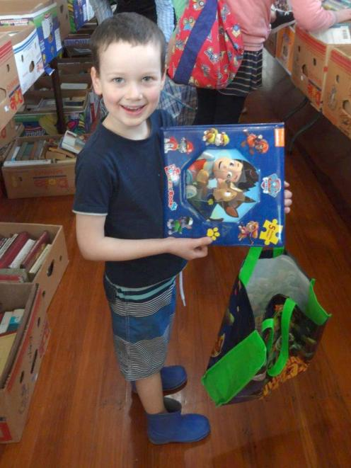 Karitane boy Jake Norgrave-Thorley (5) was delighted with his book at the Karitane school  book...