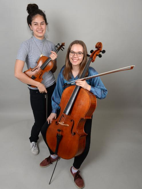Dunedin Youth Orchestra young musician award-winners violinist Ngaruaroha Martin (left) and  cellist Tessa Dalgety-Evans. Photo: Linda Robertson