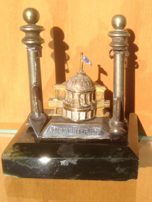 A memento (another paperweight?) presented to Alex Dempster's grandfather Alex, who was on the...