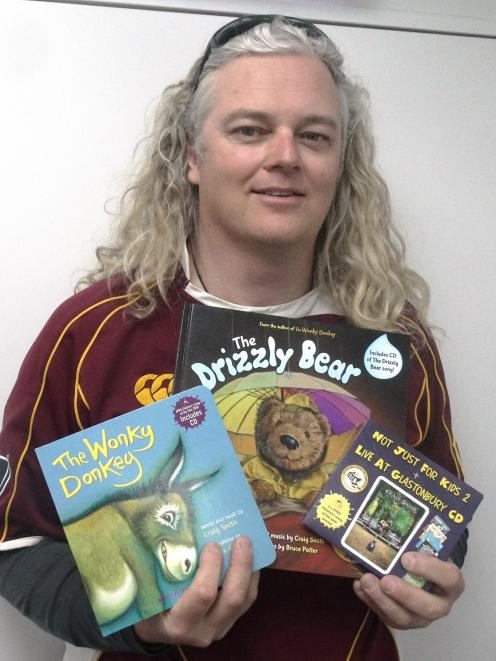 Kiwi author Craig Smith with his popular children's book, The Wonky Donkey, and his new book, The...