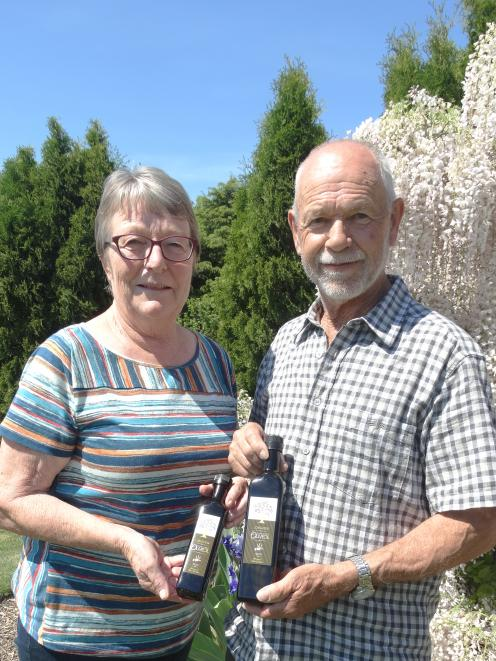 Anita and Alan Blakemore are delighted with their silver medal win at at the New Zealand Extra Virgin Olive Oil Awards. Photo: Chris Tobin