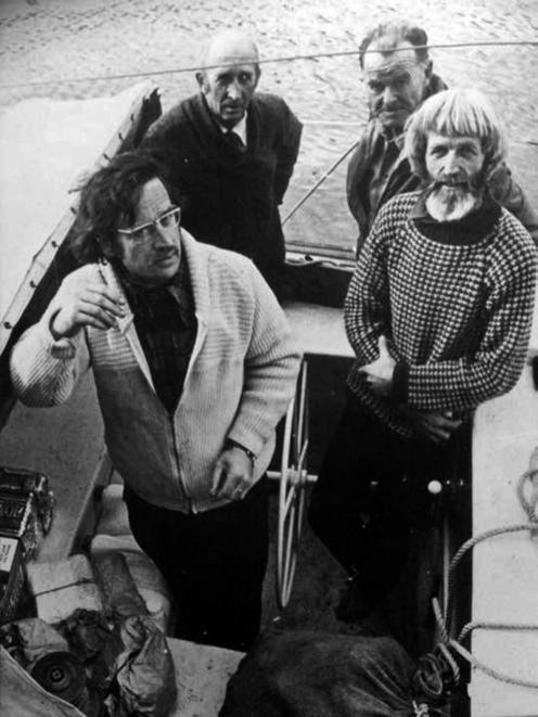 Shadbolt (left) aboard the yacht Tamure with (clockwise from back left) Jim Sharp, Jack Harker...