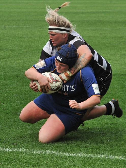 Otago Spirit prop Isla Pringle is about to go over for a try against Hawkes Bay in their Farah Palmer Cup Championship semifinal at Forsyth Barr Stadium on Saturday. Hawkes Bay No 8 Gemma Woods's tackle is too late to stop her scoring. Photo: Gregor Richa