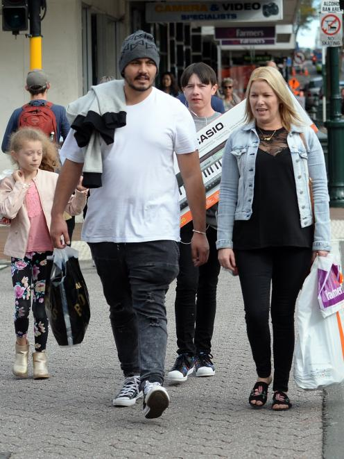 Shoppers in Dunedin's George St. Confidence in the retail sector was affected by a rise in the...