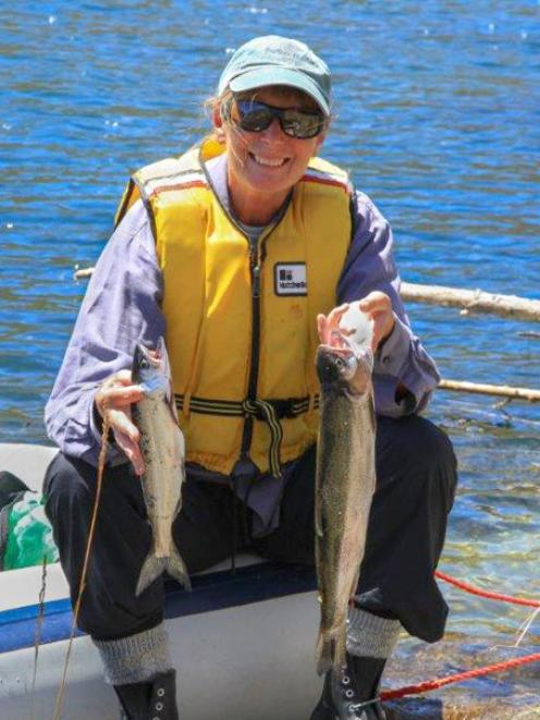 Angler Jane Forsyth, from Lake Hawea, with a Chinook salmon (left) and a rainbow trout she caught...