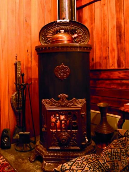 The antique refurbished log-burner sits in pride of place complementing the sense of history and...