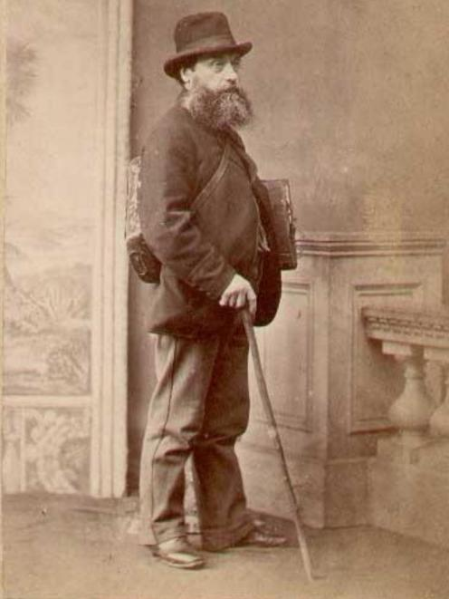 Peter Thomson dressed in his walking attire; a plant press under his arm, a vasculum for delicate...