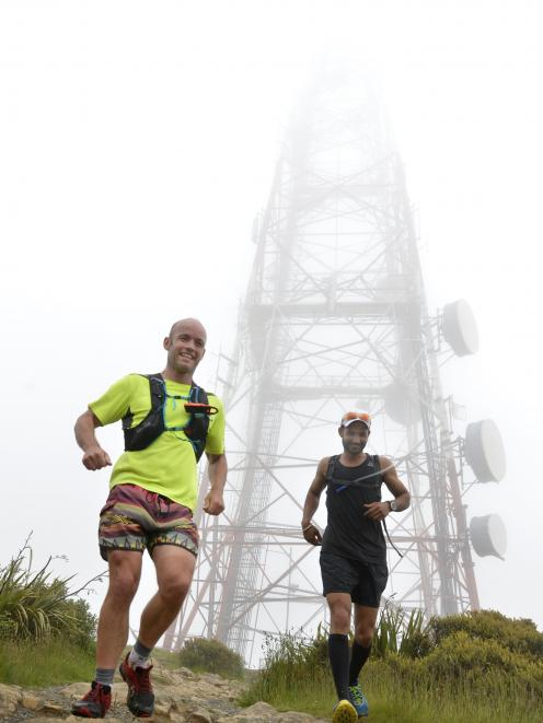 Emerging from the fog as they descend Mt Cargill are Phil Petersen (left) and Harjinder Chandra.
